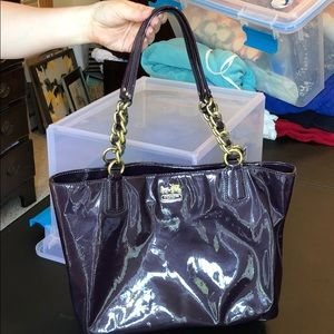 Deep purple Coach purse with gold accents